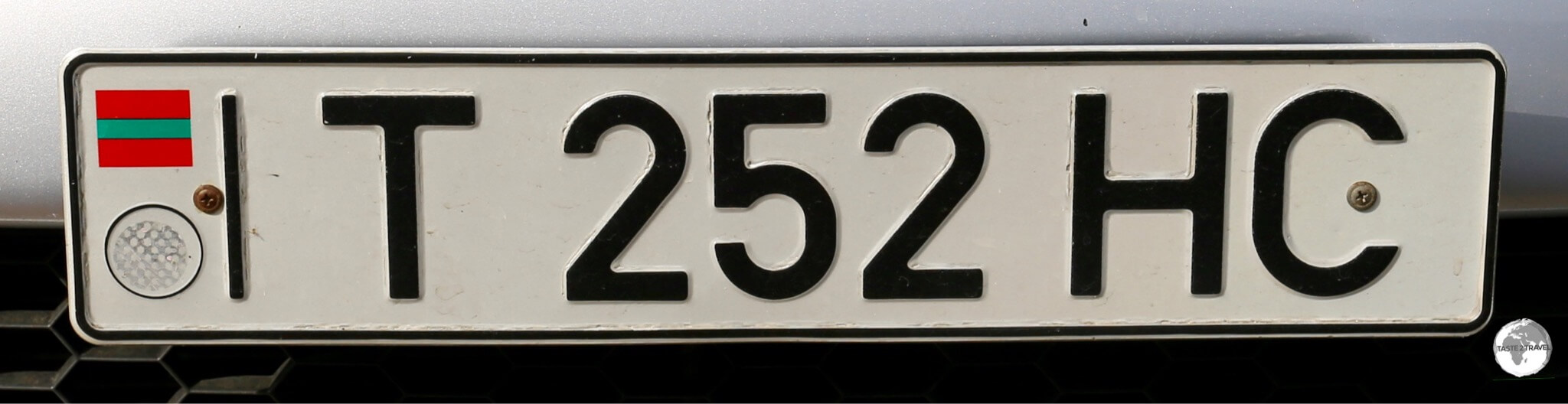 The license plate of Transnistria features the flag and also indicates which district the car is from, with 'T' representing Tiraspol.