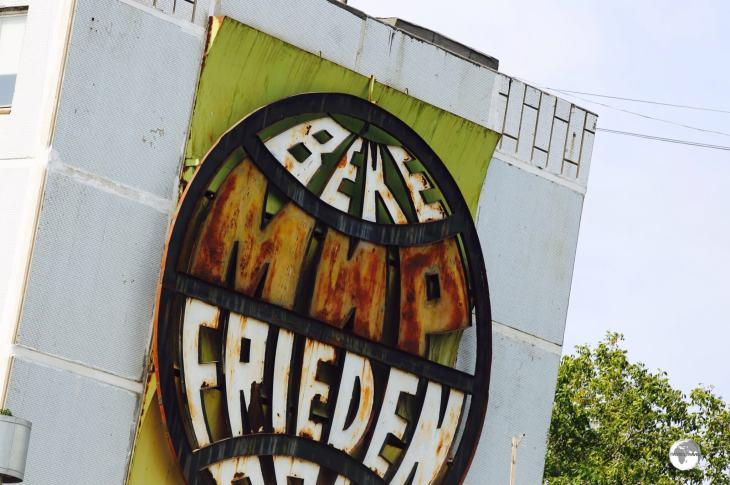 This ageing peace (Frieden) sign adorns the side of an apartment block on the road from Tiraspol to Bender.