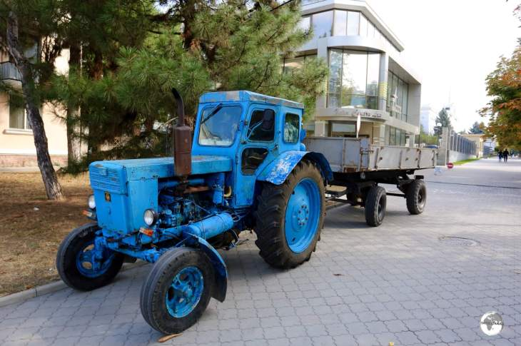 A Soviet-era tractor working on the main street of Tiraspol.