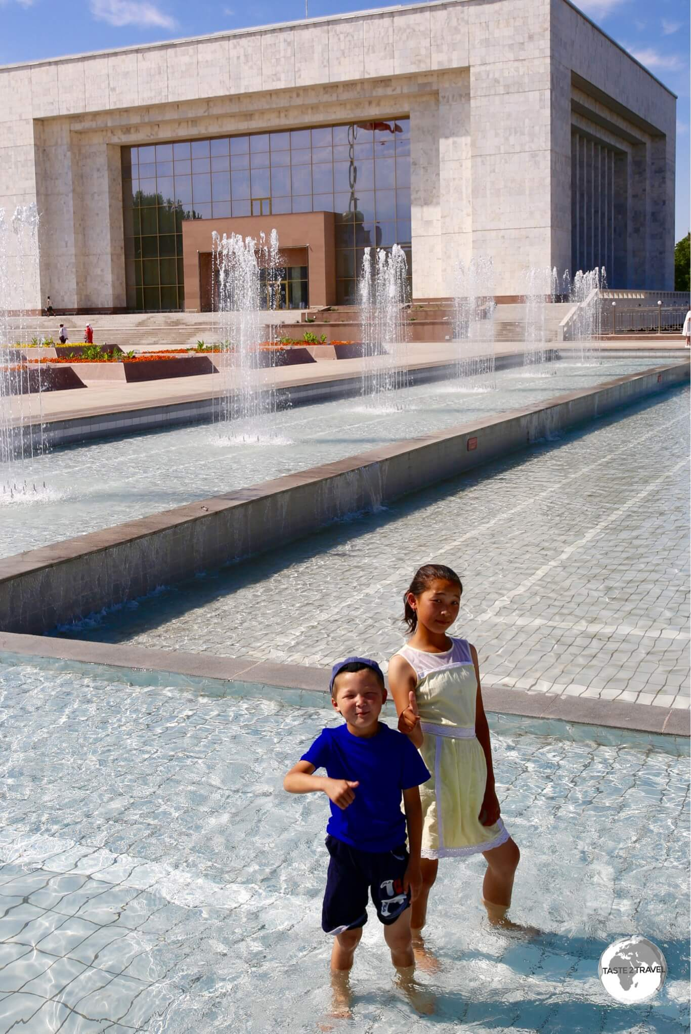 Children cooling off in one of many fountains which line Ala-Too square.