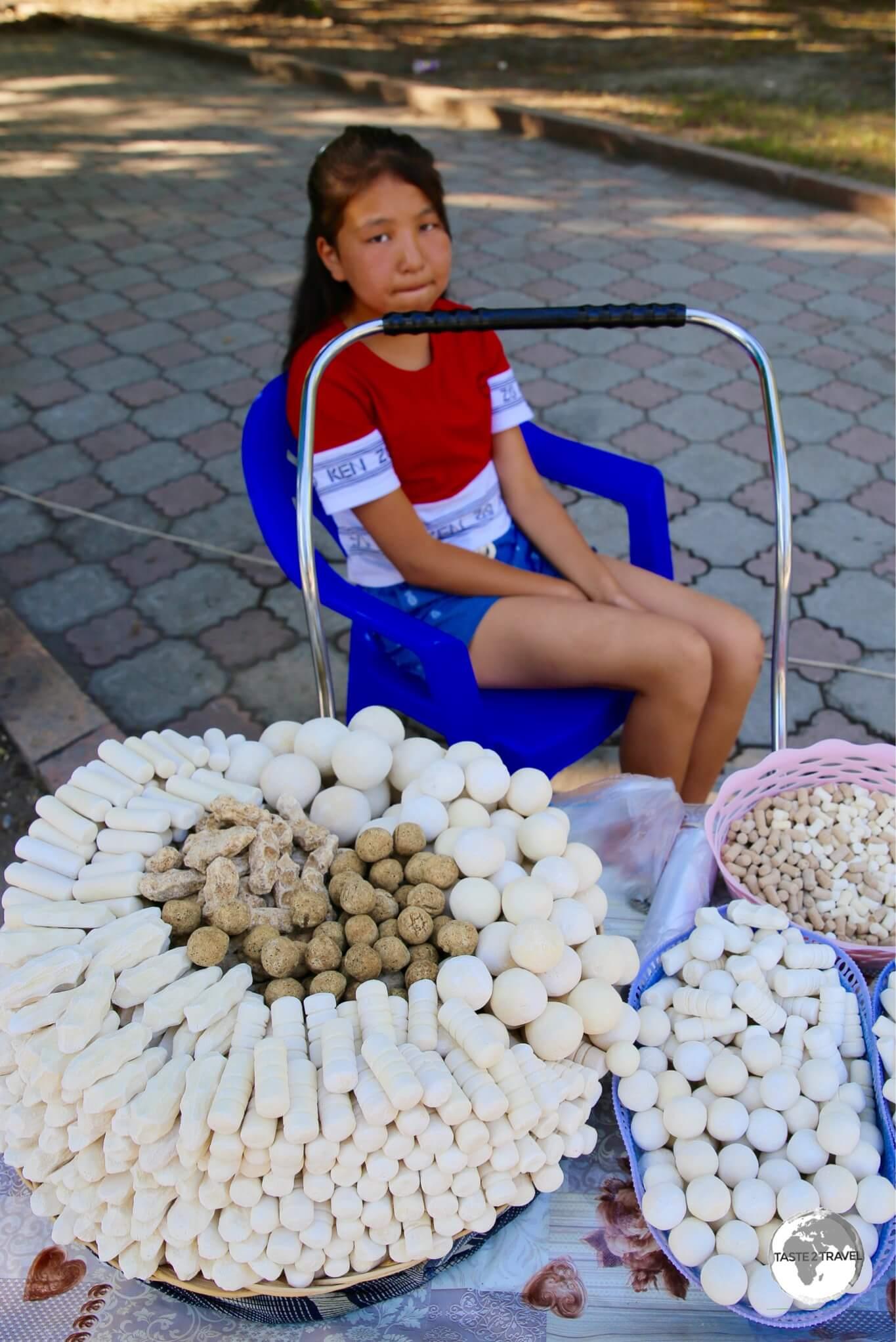 Selling Kashk or Qurt (a hard, salty fermented cheese snack) in Bishkek.