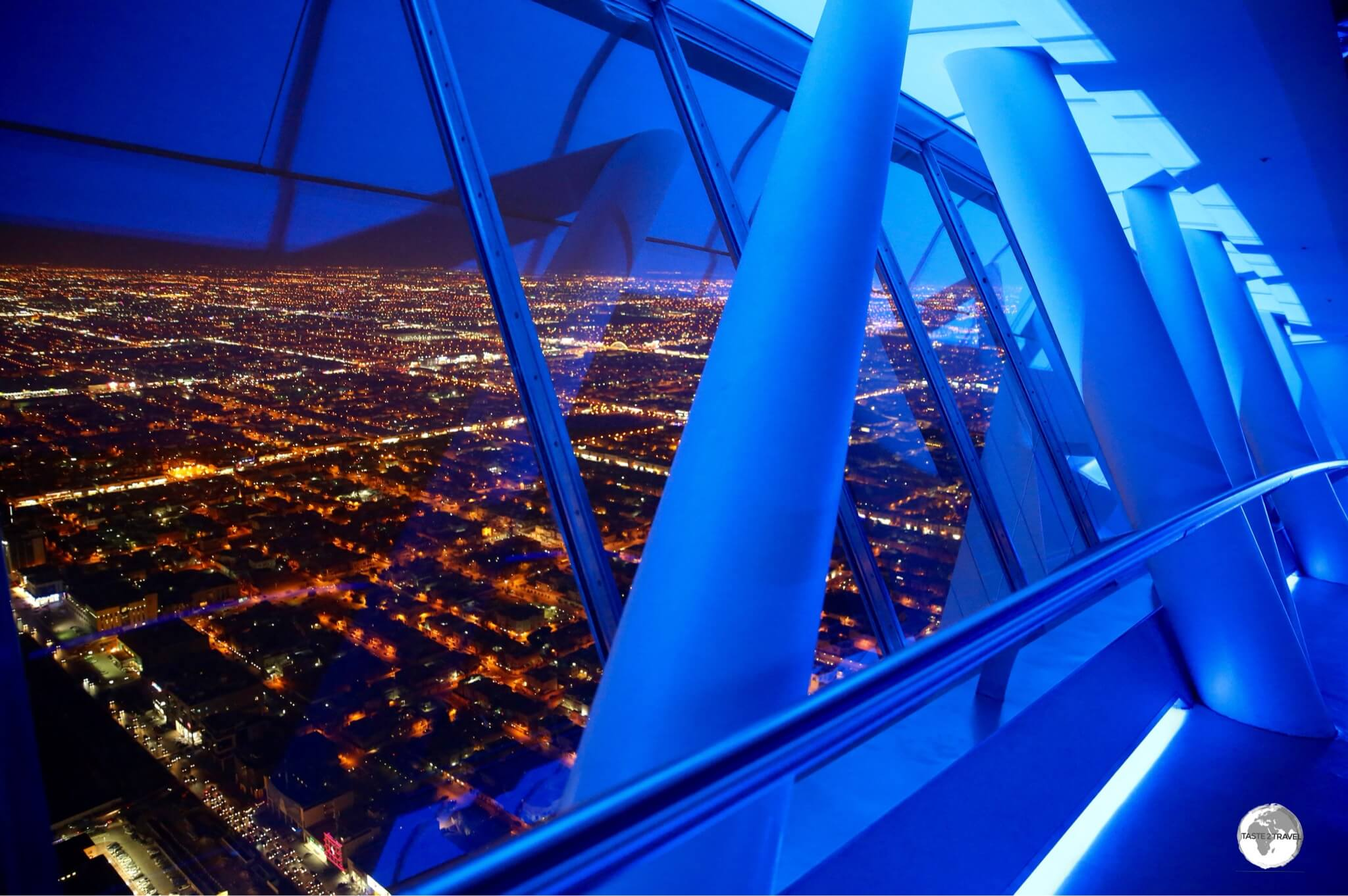 A night time view of Riyadh from a very 'blue' Sky bridge at Kingdom Centre.