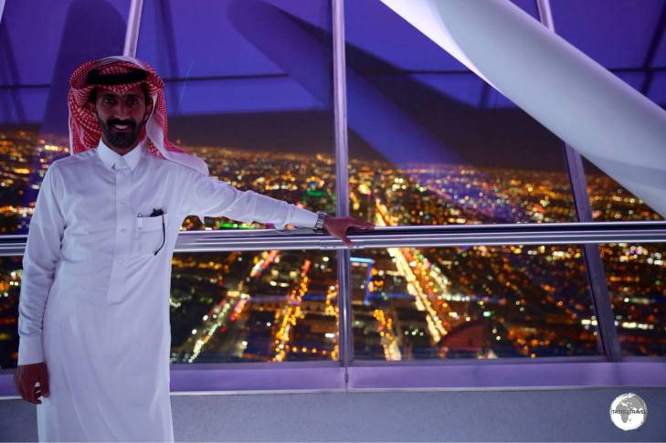 A Saudi visitor at Kingdom Tower in Riyadh wearing his white 'Thobe'.