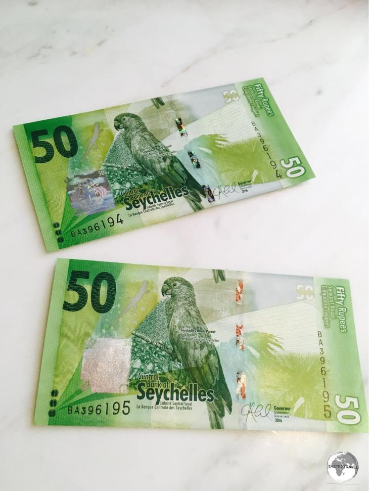 The front of the Seychelles 50 rupee note features the Black Parrot.