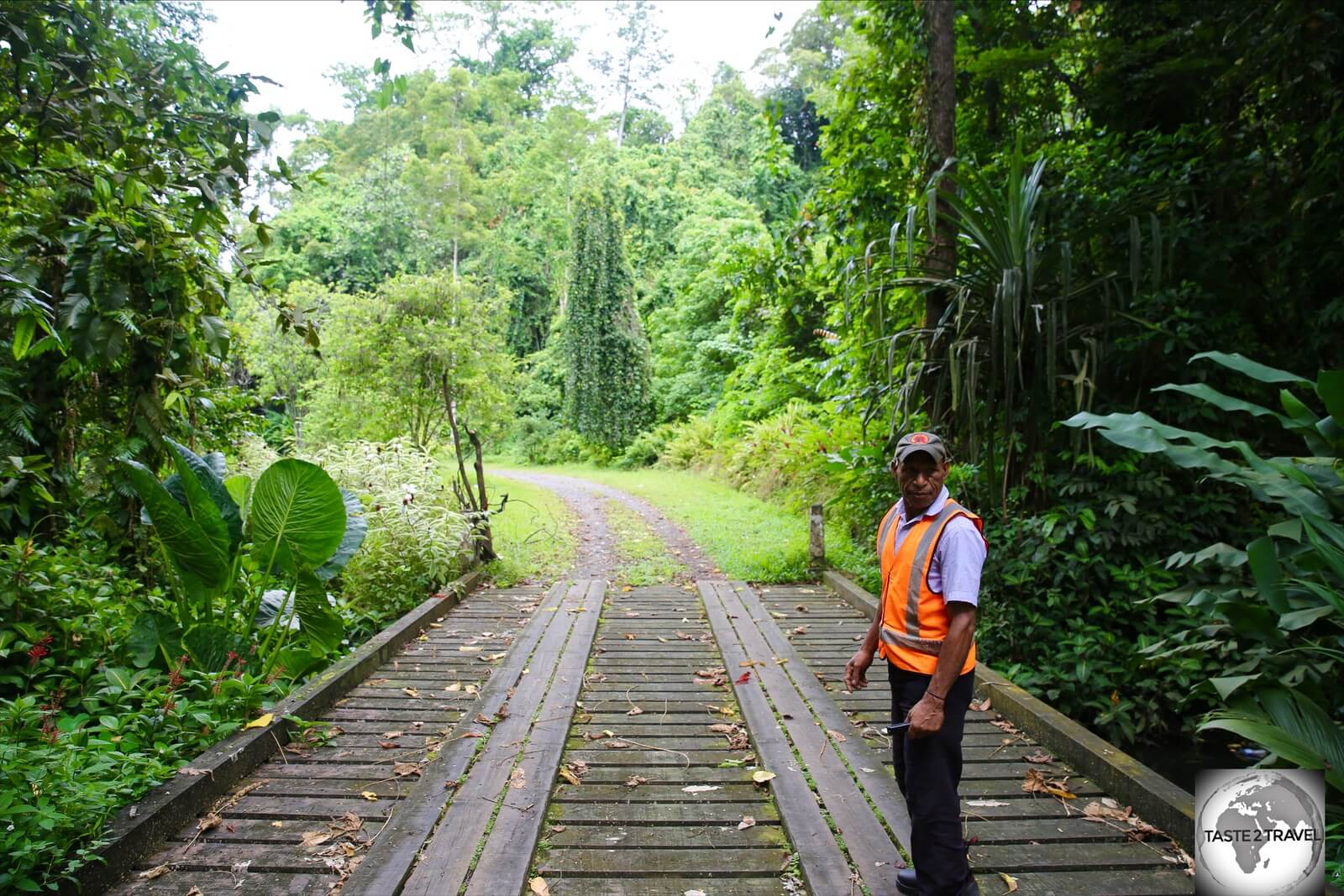 The friendly security guard at Lae Botanical Garden. I was not allowed to proceed beyond this bridge.
