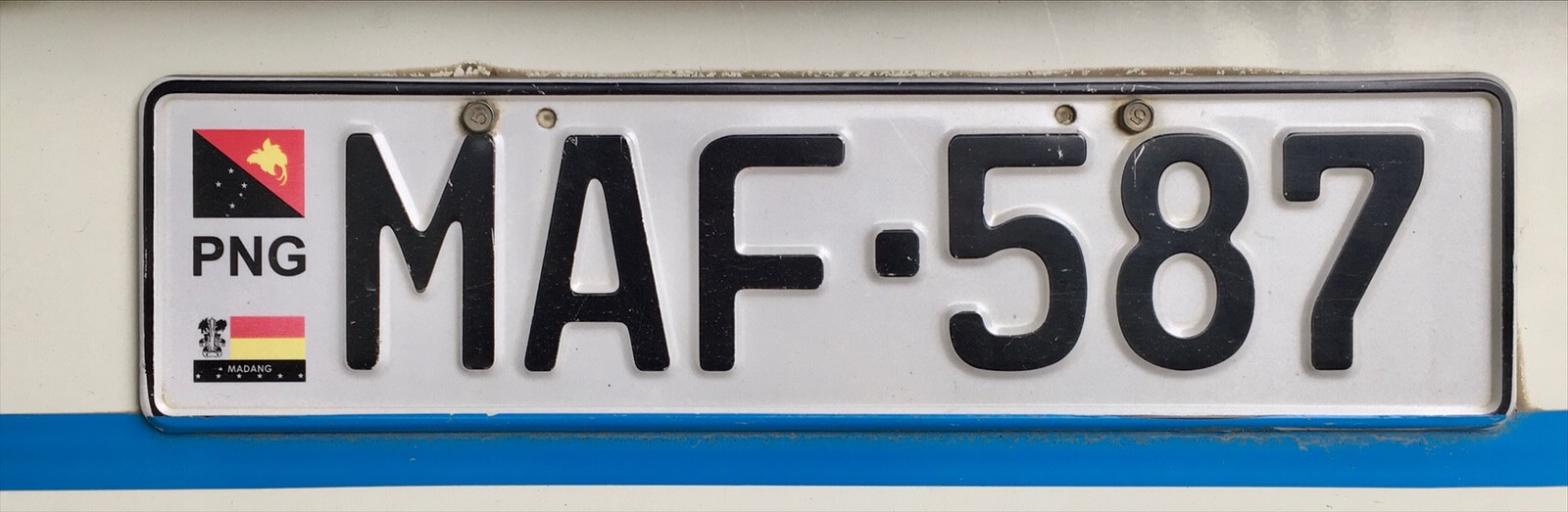 A PNG license plate, with 'the M' prefix indicating Madang province.