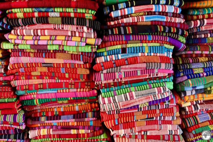 Bundles of colourful Tais cloth for sale in Dili.