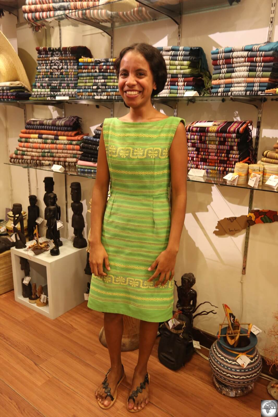 Ana, one of the friendly staff members at Things and Stories, modelling a beautiful dress made from Timorese Tais cloth.