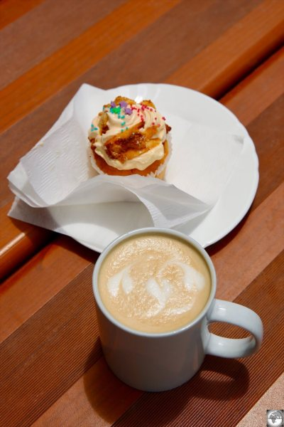 A Flat white coffee and a freshly made cupcake at the Tropicana café.