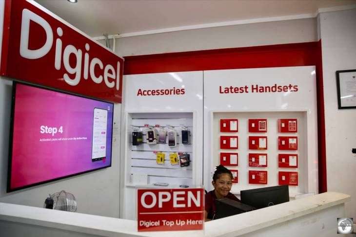 A friendly Digicel staff member at the Digicel kiosk at Capelle and Partners.