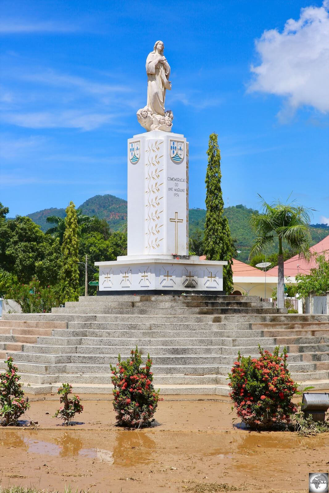 The Monument to Our Lady in Fatima Park is surrounded by a slurry of mud which washed down from the mountains during a flash flood the day before. The mud covered the entire city.