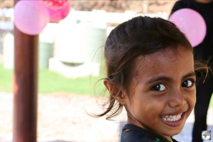 A young Timorese girl attending a birthday party at Cristo Rei in Dili.