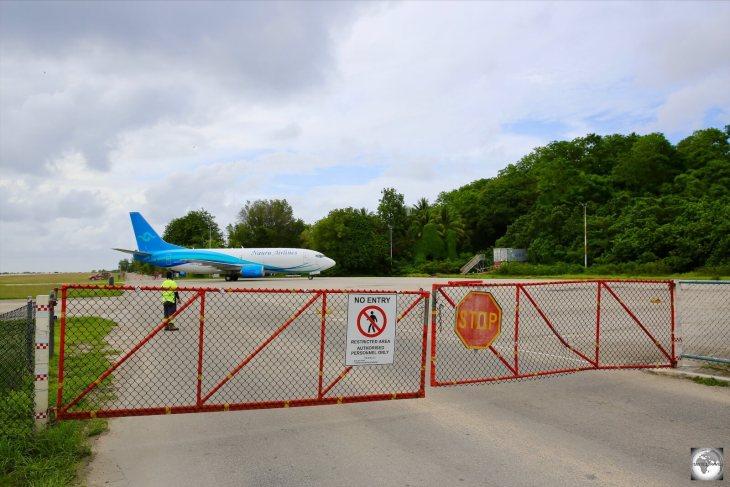 When planes are present at Nauru airport, this portion of the Island Ring road, which doubles as the taxiway and apron at the airport, is closed to traffic.