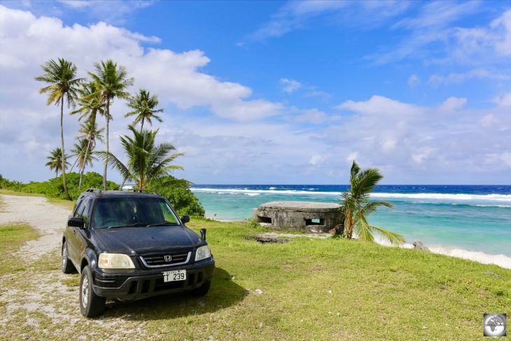 My rental car alongside one of the Japanese WWII pillboxes (concrete dug-in guard post), which can be seen along the coast of Nauru.