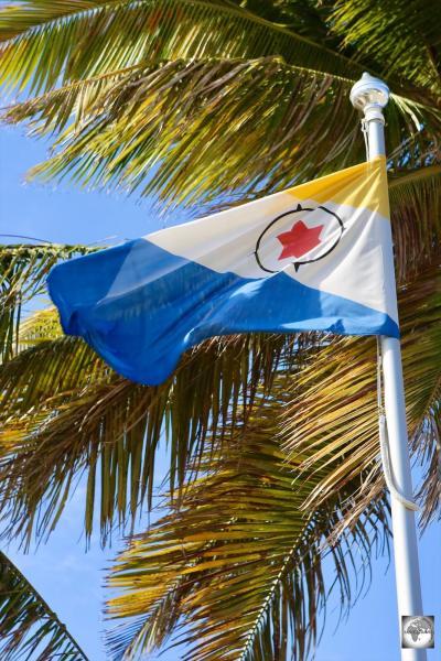 The flag of Bonaire, flying in downtown Kralendijk.