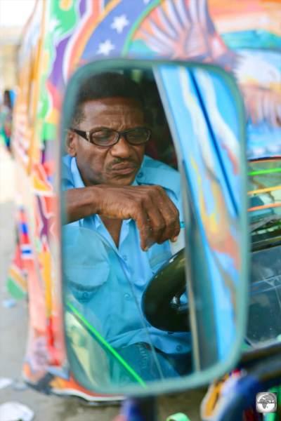 A 'Tap-Tap' (public minivan) driver in downtown PAP.