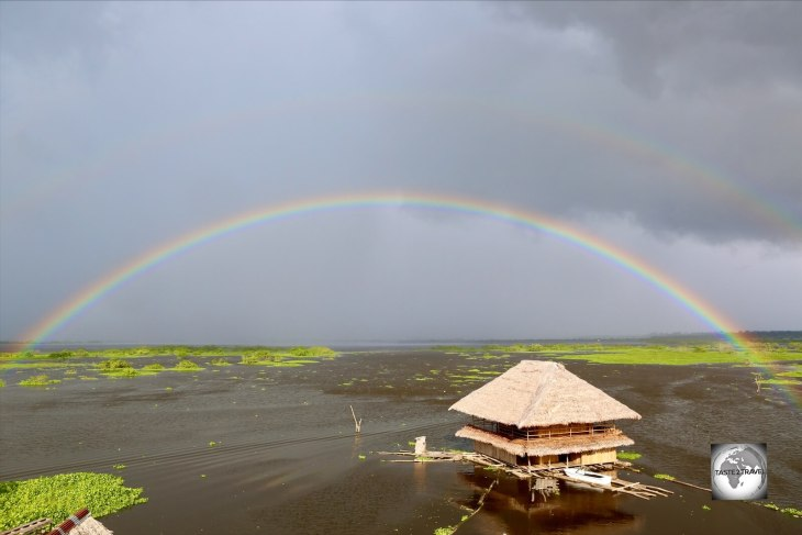A rainbow forms over the Amazon river at Iquitos.
