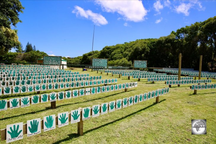 A park in Burnt Pine displays the handprints of islanders who have put their 'Hands Up for Democracy'.