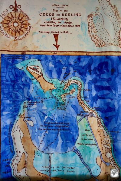 A hand-painted map of the Cocos (Keeling) Islands, showing the circular shape of the barrier islands.