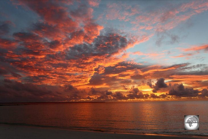 A fiery sunset at Sandy Point, the finest beach on Home Island.