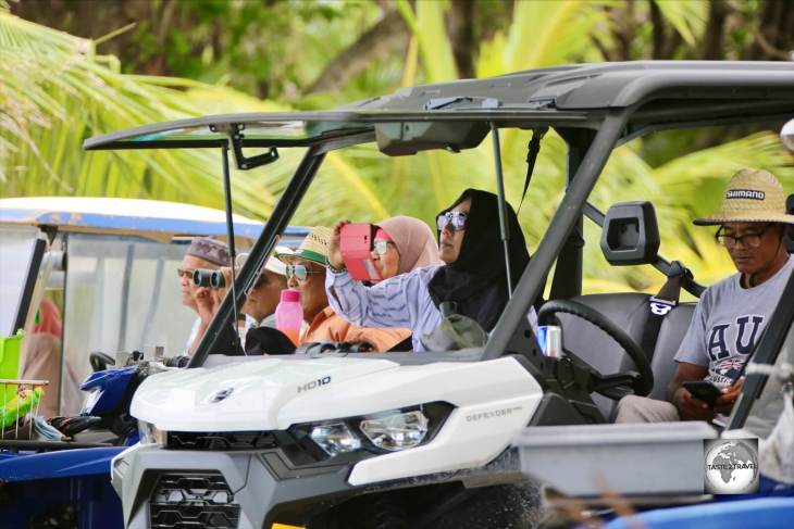 Cocos Malay locals on Home Island watching the monthly Jukong boat race from the comfort of their buggies.