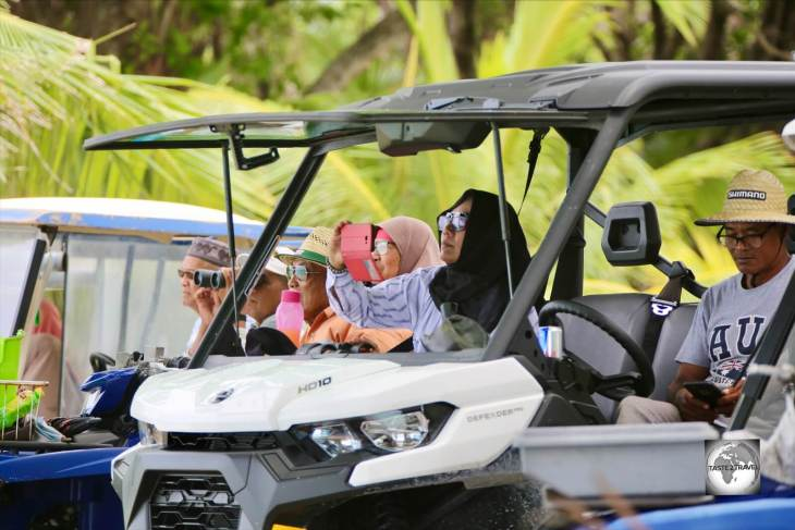 Cocos Malay locals on Home Island, watching the Jukong race from the comfort of their buggies.