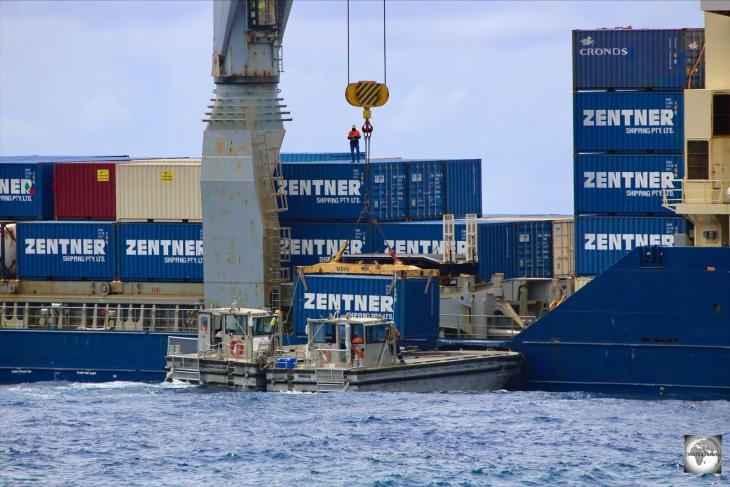 Shipping containers at Christmas Island are offloaded onto barges and then transported to shore.