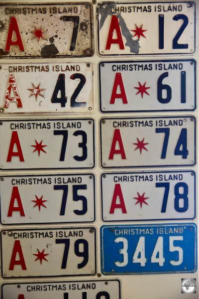 A display of old Christmas Island License plates at the Tai Jin House museum.