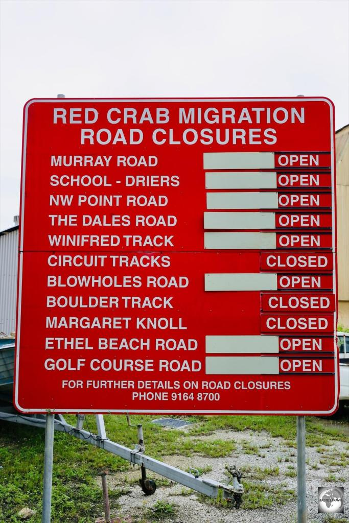 A road sign in Settlement indicates road closures during the Red Crab migration season.