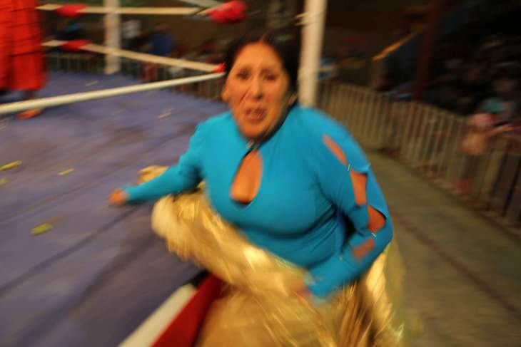 After I photographed her being thrown out of the ring, this cheeky Cholita decided she would playfully slap me, which earned her a round of applause from the audience.