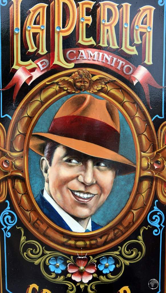 A portrait of Carlos Gardel in the 'La Perla de Caminito' bar, a highlight of the La Boca entertainment neighbourhood of Buenos Aires.
