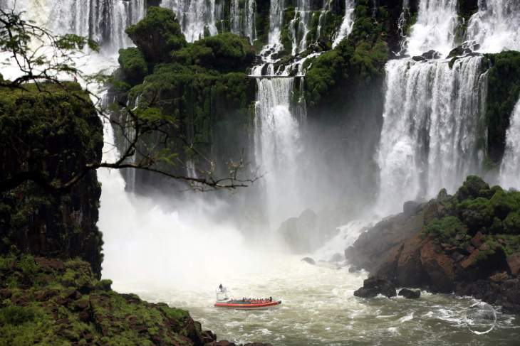 Passengers in a Brazilian tour boat, feeling the spray at the base of Iguazú Falls.