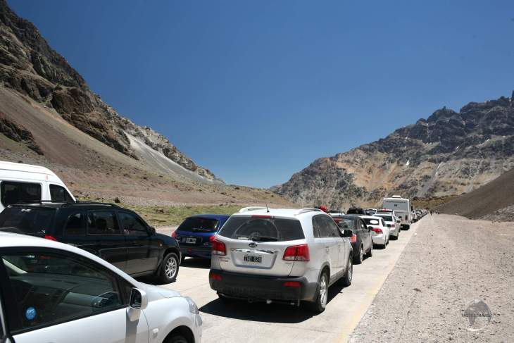 A long line of traffic on the Argentine side of the 'Paso Internacional Los Libertadores', waiting to cross the border into Chile.