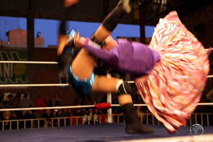 A whirl of colour as the Cholitas grapple, pull braids, give chokeholds, and make some (very theatrical) leaps from the ropes.