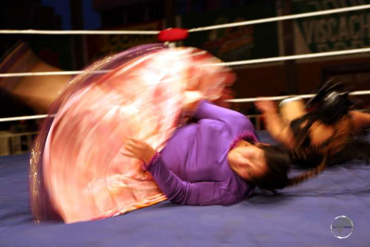 Cholita wrestling is inspired by the 'lucha libre' style of wrestling, which originated in Mexico.