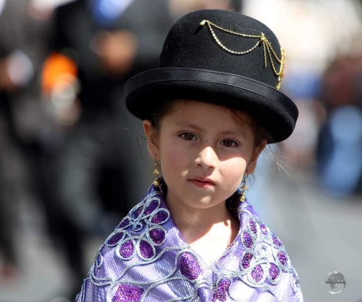 A young participant in the 'Fiesta de la Virgen de Guadalupe' in Sucre, Bolivia.