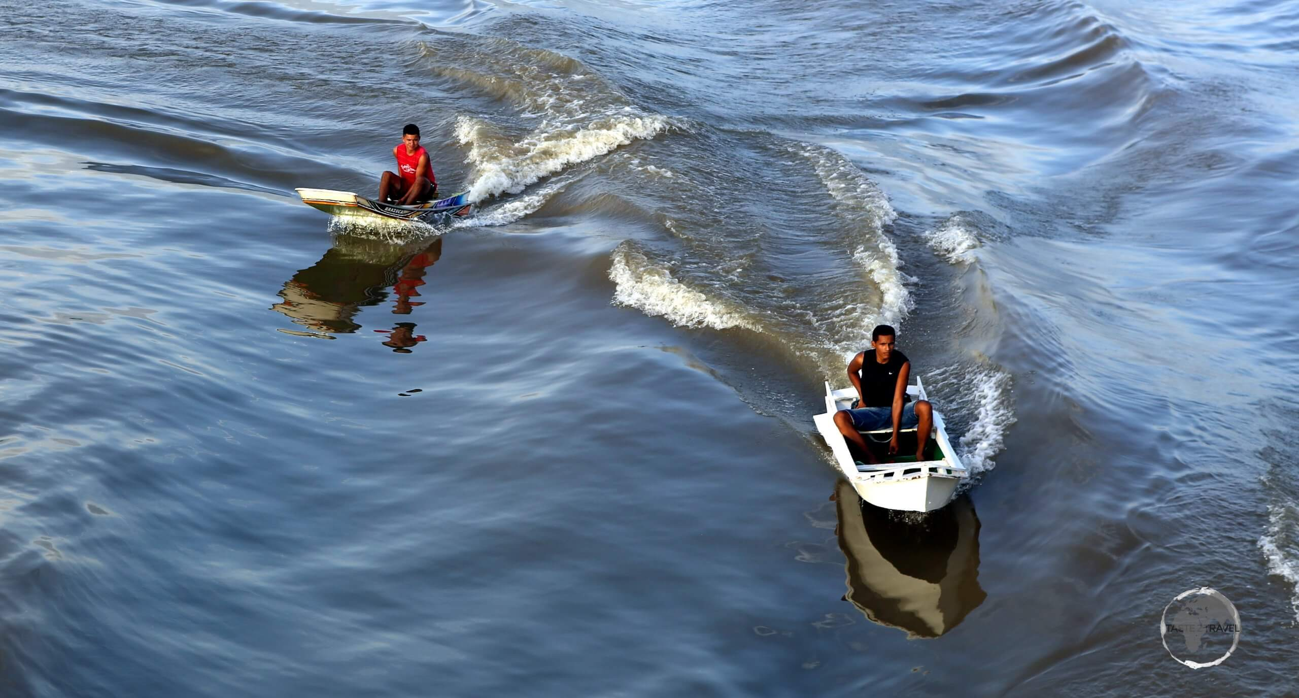 Life on the Amazon river - young villagers speeding alongside our boat in their zippy speedboats.