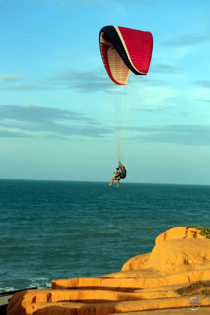 Hand gliding over the beach at Canoa Quebrada, Ceará state, Brazil.