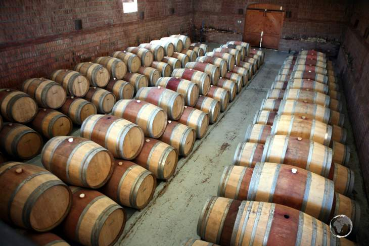 Barrels of Cabernet Sauvignon red wine, maturing at a winery in central Chile.