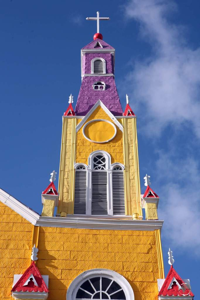 The roof and exterior walls of the 'Iglesia de San Francisco', in Castro, Chiloé Island, are lined with sheets of brightly painted galvanized iron.
