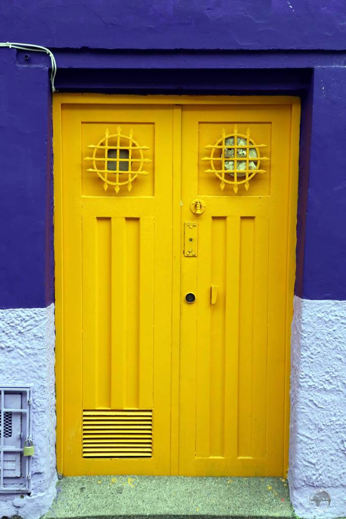 A colourful doorway in the historic 'La Candelaria' district, the vibrant heart of Colombia's capital city.