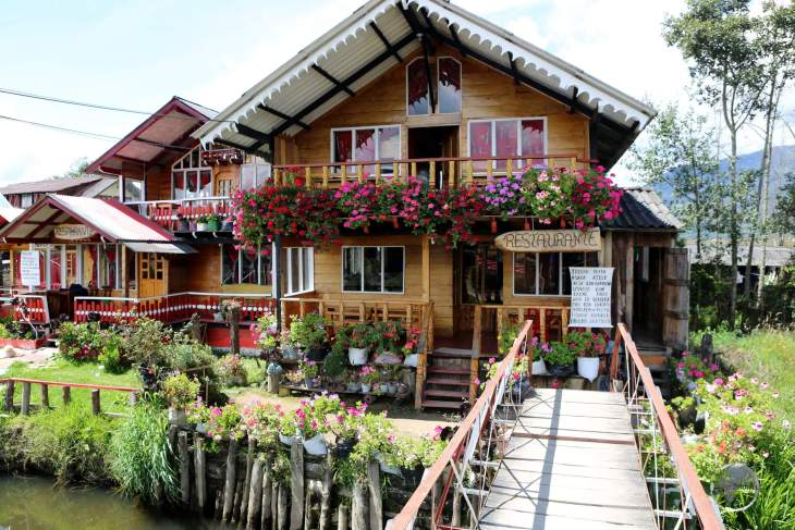 Swiss-style houses line the streets of a small tourist village at Laguna La Cocha. The speciality of the local restaurants is trout which is caught in the lake.