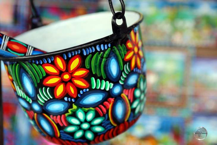 Colourful, hand-painted kitchenware at the Otavalo craft market.
