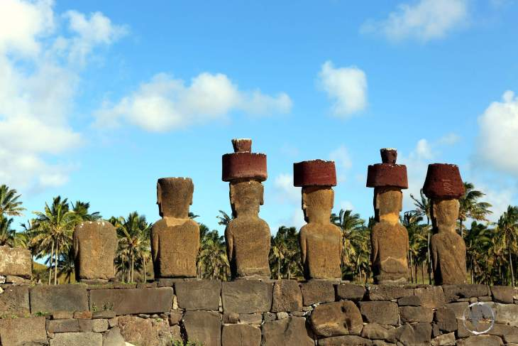 Overlooking Anakena beach, Ahu Nau Nau features four moai which are crowned with red, volcanic pukao.