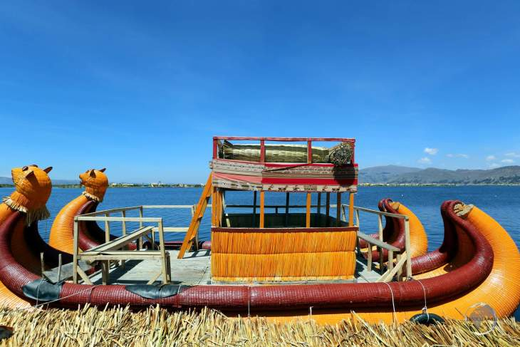 """About to board a Totora reed boat for a tour of the Uros islands. Each step on the spongy, floating islands, sinks about 2-4"""" depending on the density of the ground underfoot."""