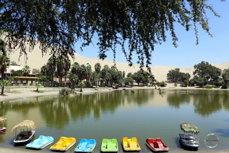"""Huacachina is built around a small natural desert lake, commonly referred to as the """"oasis of America""""."""