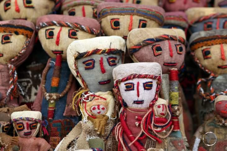 Souvenir dolls for sale in Pisac market, a good place to shop for local Quechua handicrafts.