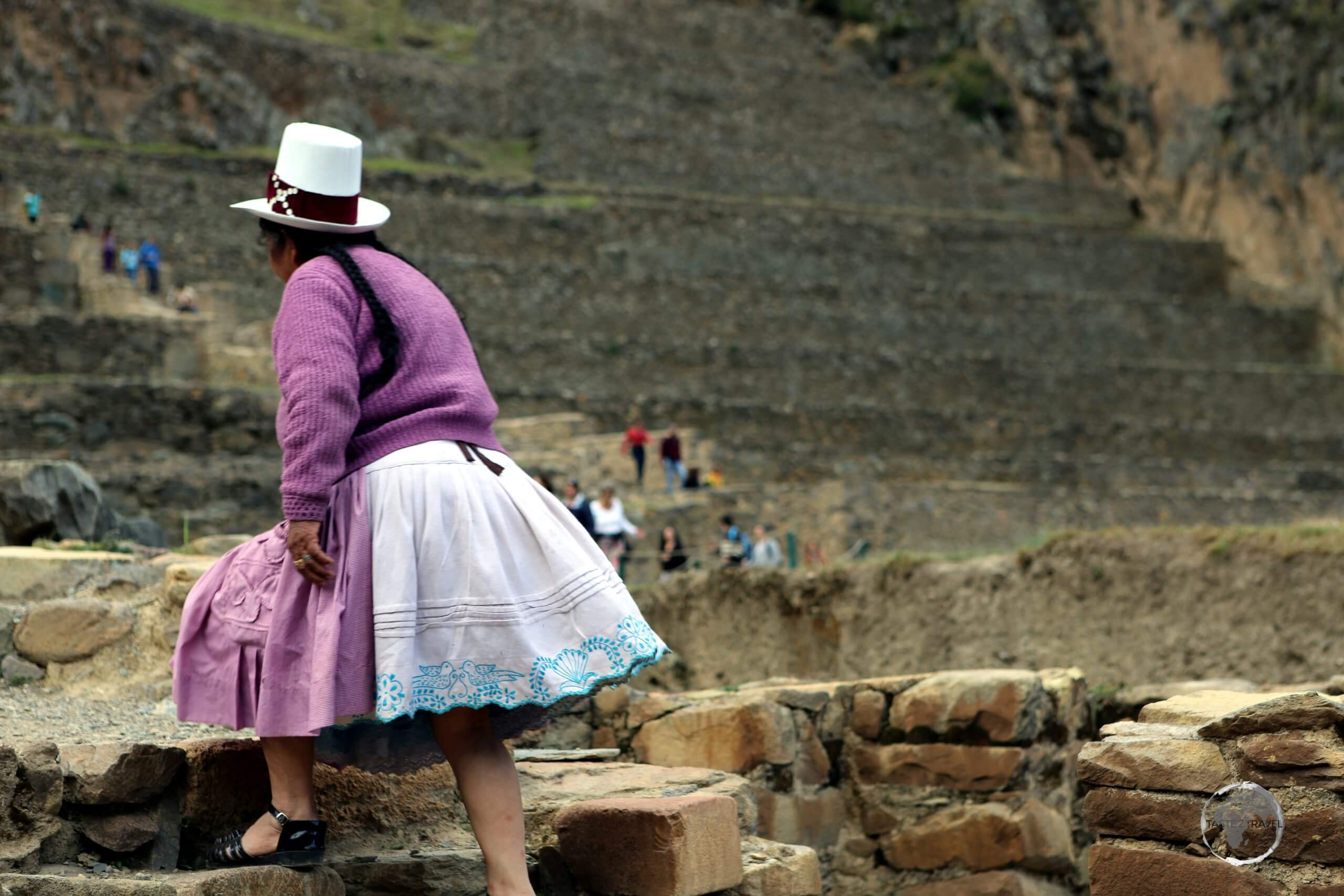 A Peruvian tourist, exploring Ollantaytambo ruins. Built in the 1400s, the large Inca fortress soars above the cobbled streets of Ollantaytambo town, 95 km north of Cuzco.