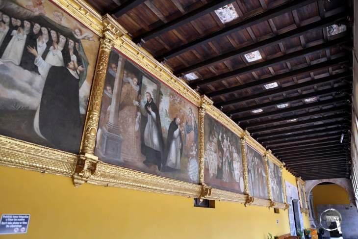 Religious artworks adorn the walls of a colonnade, at the Convent of Santo Domingo, which the Spanish built over the top of the Inca-built Coricancha in Cusco, Peru.