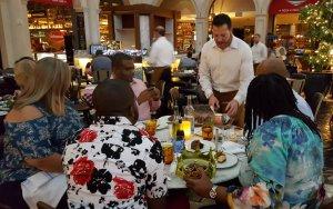 Server preparing dessert on a private food tour